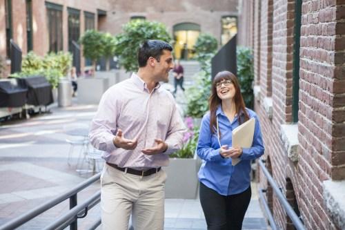employees-talking-and-walking